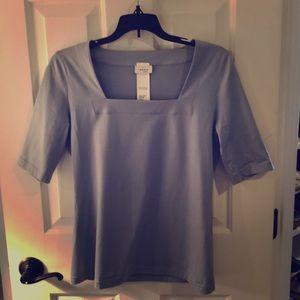 Akris Punto Light blue short sleeve blouse.